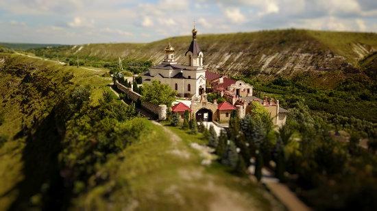 Aerial view of Orhei Vechi Monastery in Moldova in tilt-shift video